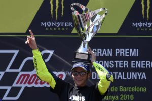 First-placed Movistar Yamaha MotoGP's Italian rider Valentino Rossi celebrates on the podium of the Moto GP race of the Catalunya Grand Prix at the Montmelo racetrack near Barcelona on June 5, 2016. / AFP PHOTO / LLUIS GENE