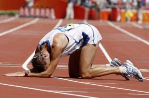 Alex Schwazer of Italy lies on the track after winning gold in the men's 50km walk during the Beijing 2008 Olympic Games in the National Stadium, Beijing, China, 22 August 2008. ANSA/KERIM OKTEN